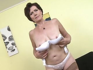 Older Lady Ryanne Shows Off Her Assets And Plays With Her Honeypot